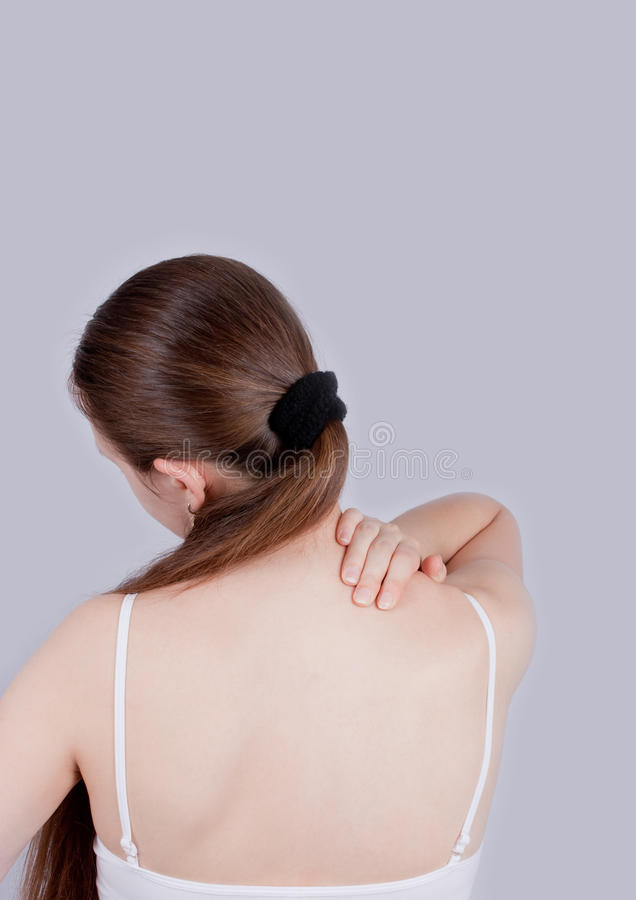 Back and neck pain. Young beauty woman under back and neck pain attack royalty free stock photos
