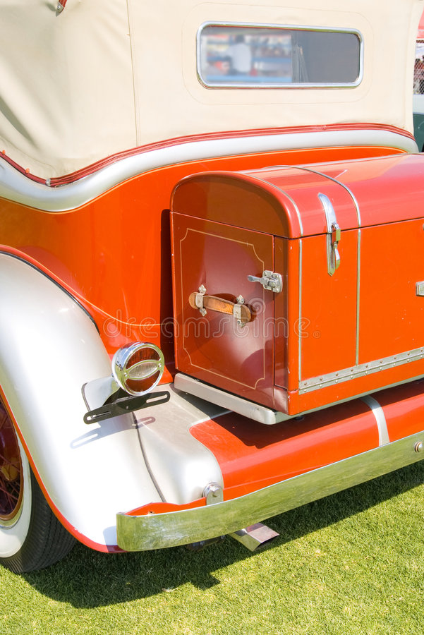 Back old red car. Back side luggage old red car royalty free stock images
