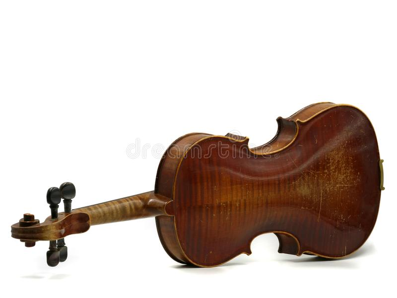 Back of an old scratched wooden violin isolated on white background.  royalty free stock photo