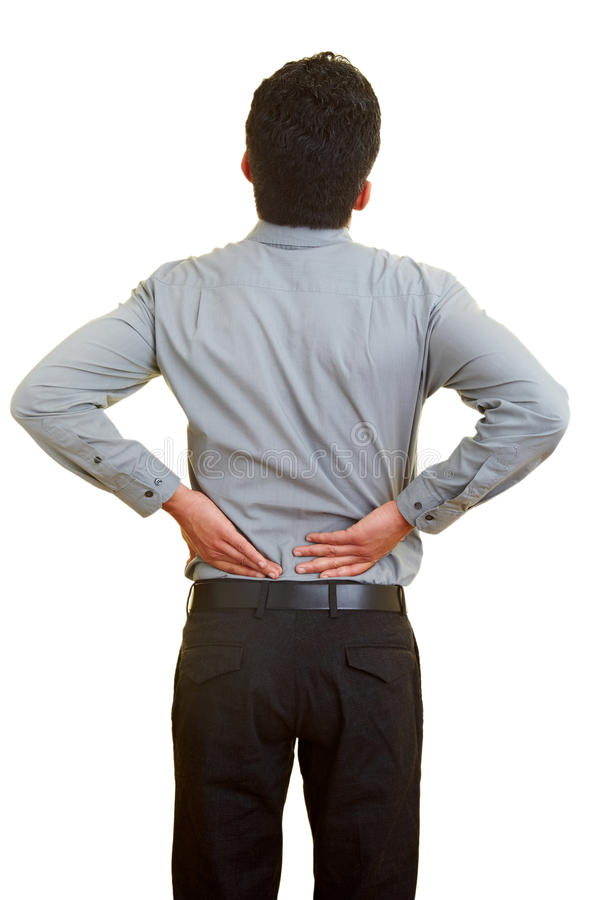 Back pain. Man standing with pain in his back stock photo
