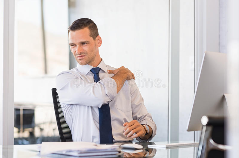 Back pain at work royalty free stock photos