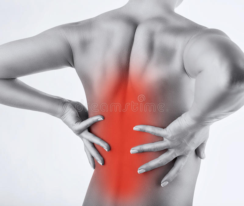 Back pains. Woman with back pain isolated on white background stock photos