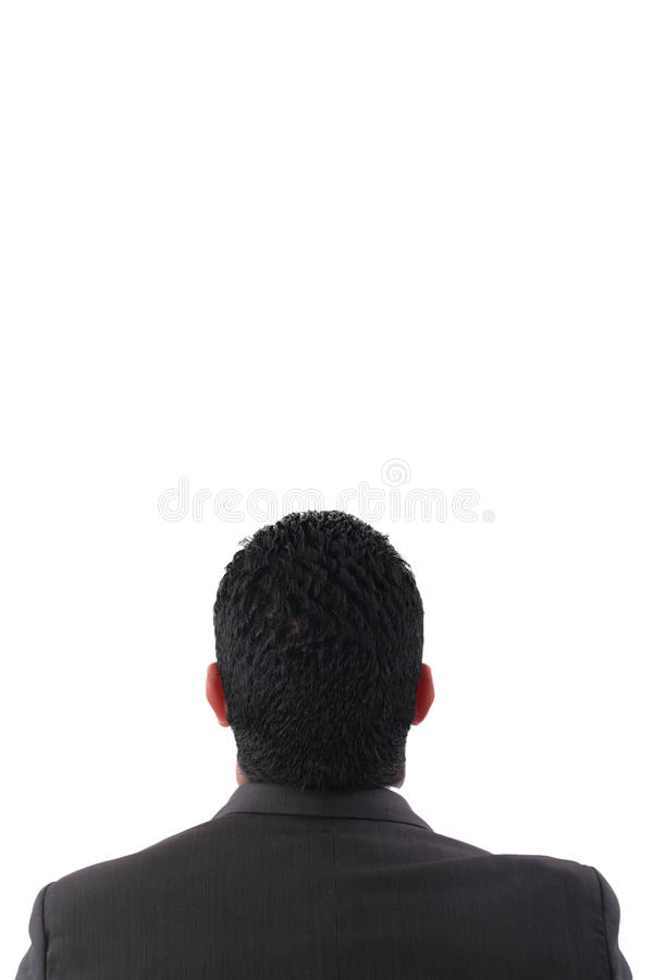 Back of pensive businessman looking up royalty free stock photography