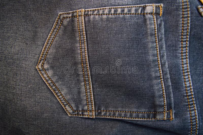 Back pocket of denim pants. Background. Place for text. Free royalty free stock photo