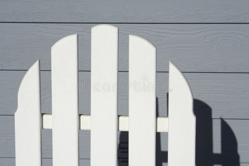 Back of porch chair royalty free stock photo