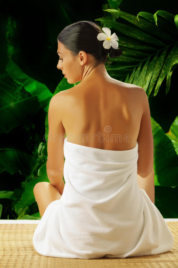 Back. Portrait of young beautiful woman in spa environment . banner stock photo