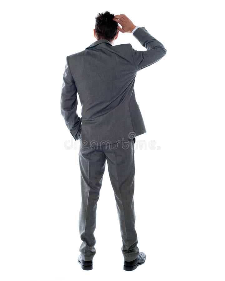 Back-pose of a corporate person thinking stock photography