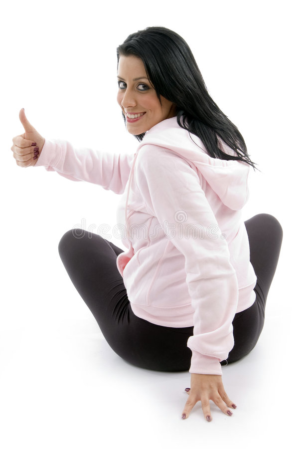 Back pose of female with thumbs up royalty free stock photography