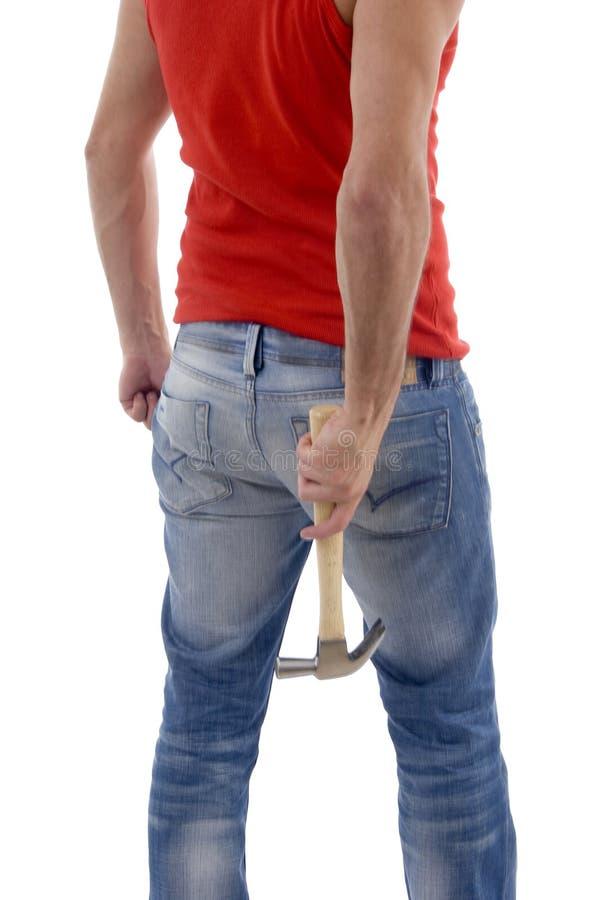 Back pose of man holding hammer royalty free stock image