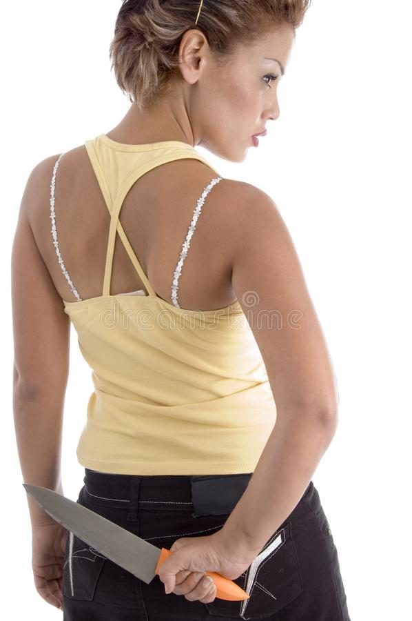 Download Back Pose Of Woman With Knife Stock Image - Image: 7043631
