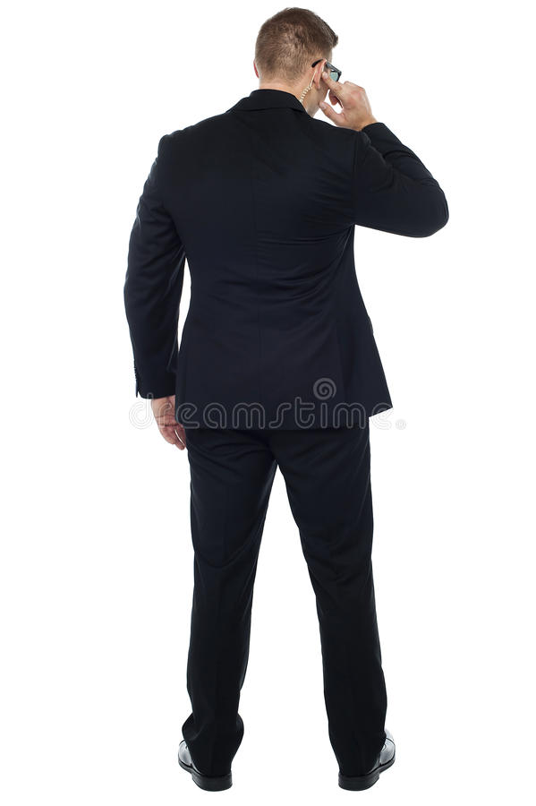 Back pose of young male security person stock photo