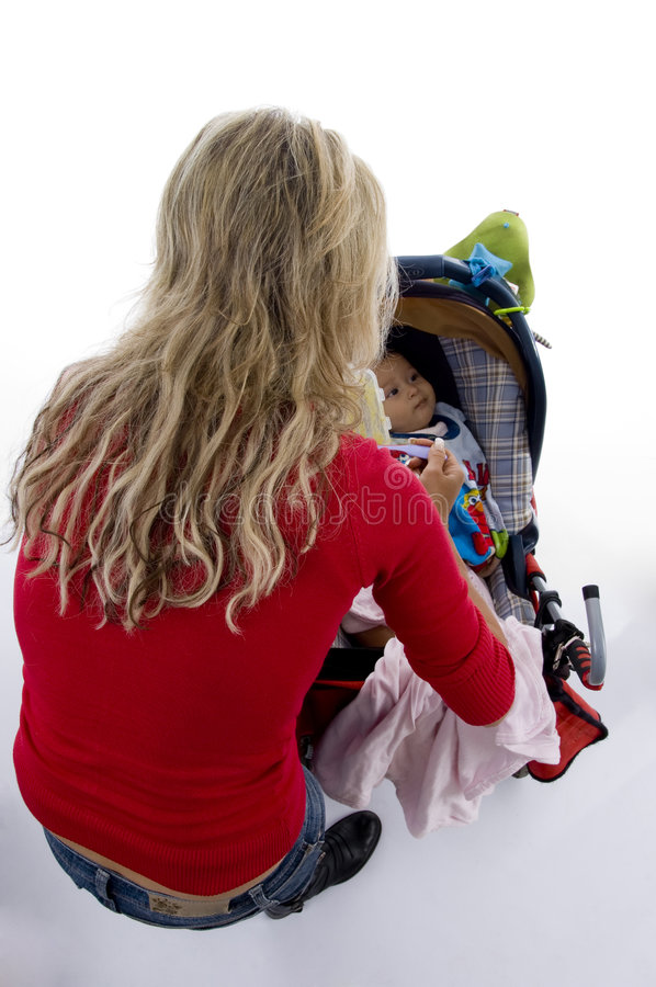 Download Back Pose Of Young Mother With Her Baby In Pram Stock Photo - Image: 7139226