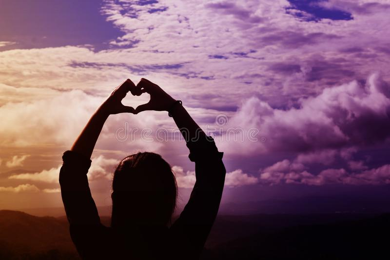 Back or rare view women do hand symbol of heart in fantasy dream stock image