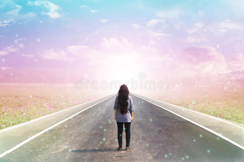 Back or rare of women standing on pavement road with dreamy morn stock images