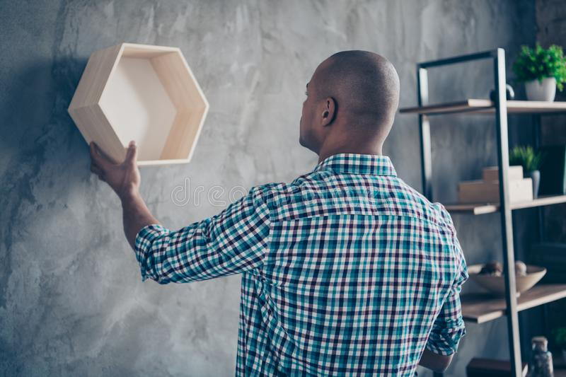 Back rear side view portrait of focused professional have shelf occupation lumber antique hang dressed casual checked royalty free stock image