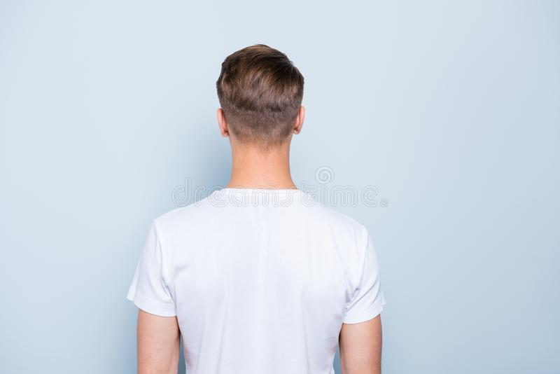 Back rear view photo of confident, attractive, nice-looking man stock photography