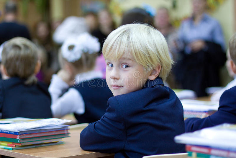 Back in school - boy in classroom stock photos