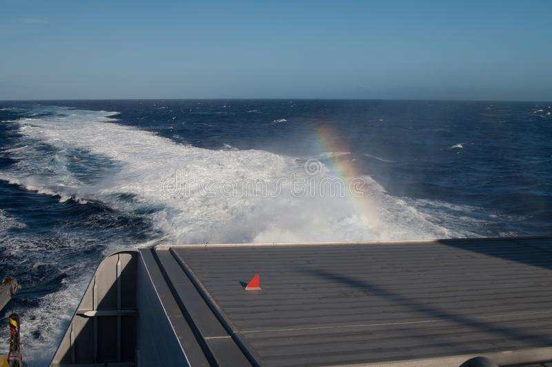 Back of a ship, wake and rainbow. Atlantic ocean. Canary Islands. Spain stock image
