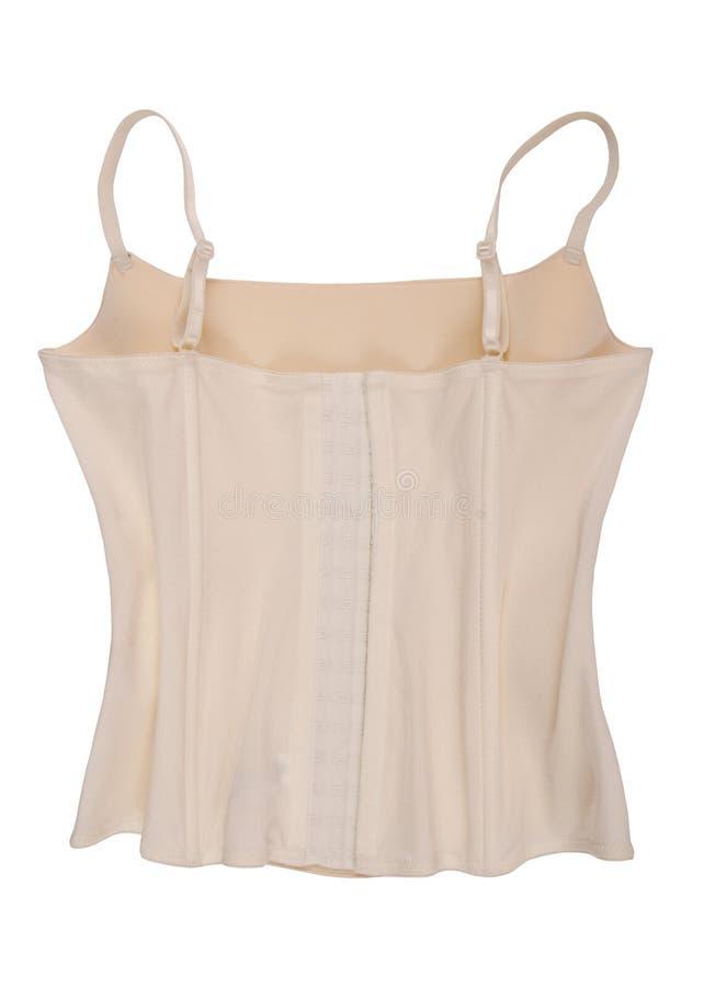 back side of body-colour corset, white corset, female underwear, backwards of beige korset, isolated white corselet stock image