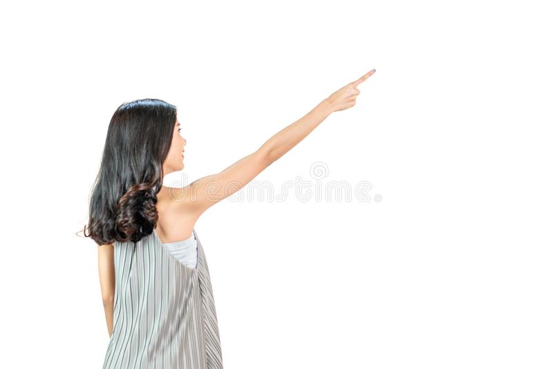 Back side body of Young asian woman standing pointing to something,long hairs black color, isolated on a white background stock photos