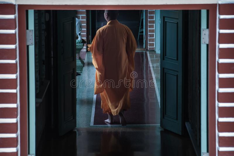 Back side of chinese  monks of Buddhism is walking on pathway in a temple royalty free stock photos