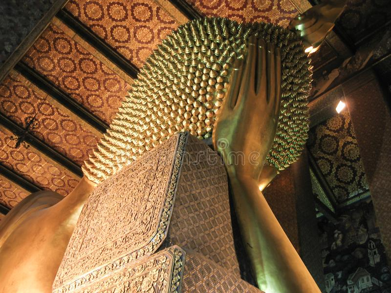 Back side of giant golden Reclining Buddha statue. stock photography