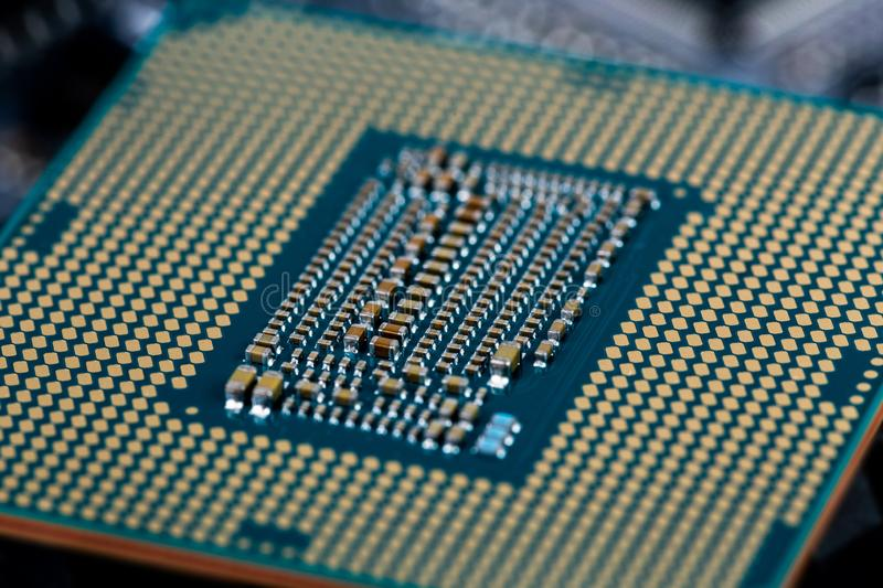 Back side of modern lga 1151v2 central processor unit - closeup with selective fcus and blur.  royalty free stock photo