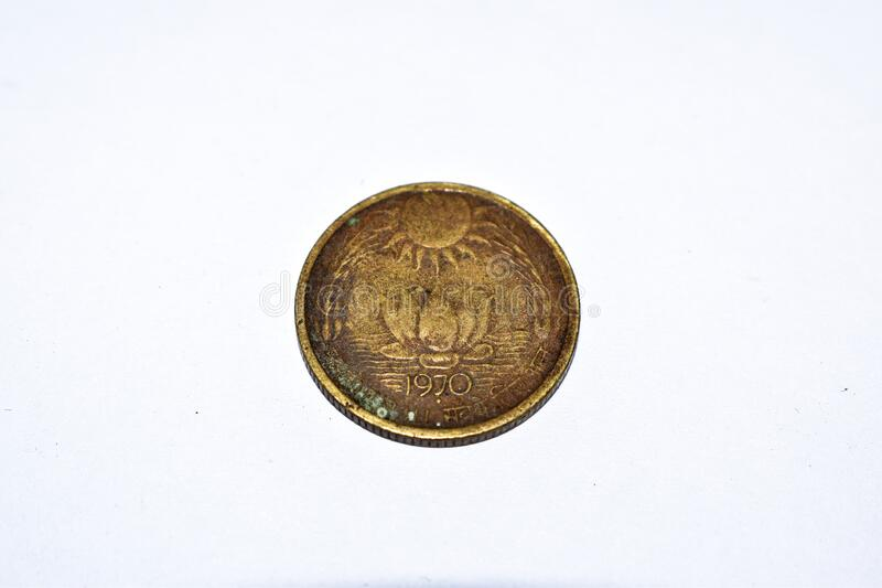 Back side of Old Indian 20 paise coin. Year 1970 vintage coin. White background royalty free stock photography