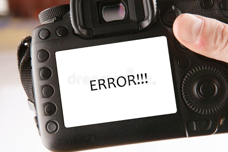 Back side of professional dslr digital photo camera with text error on screen royalty free stock photo