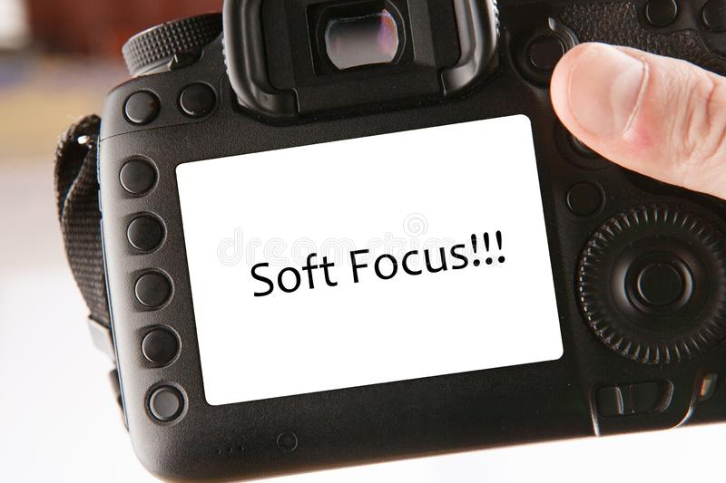 Back side of professional dslr digital photo camera with text soft focus on screen royalty free stock photo