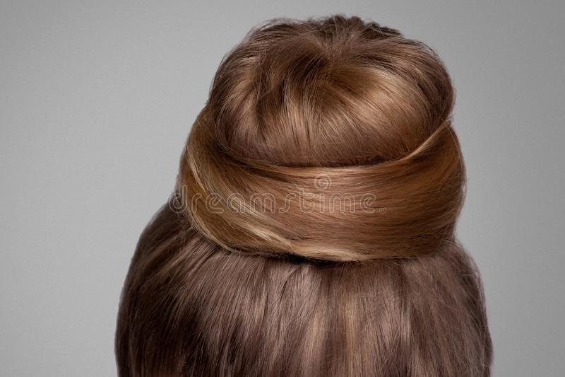 Back side view closeup portrait with creative elegant brown collected hairstyle, bun hair royalty free stock photos