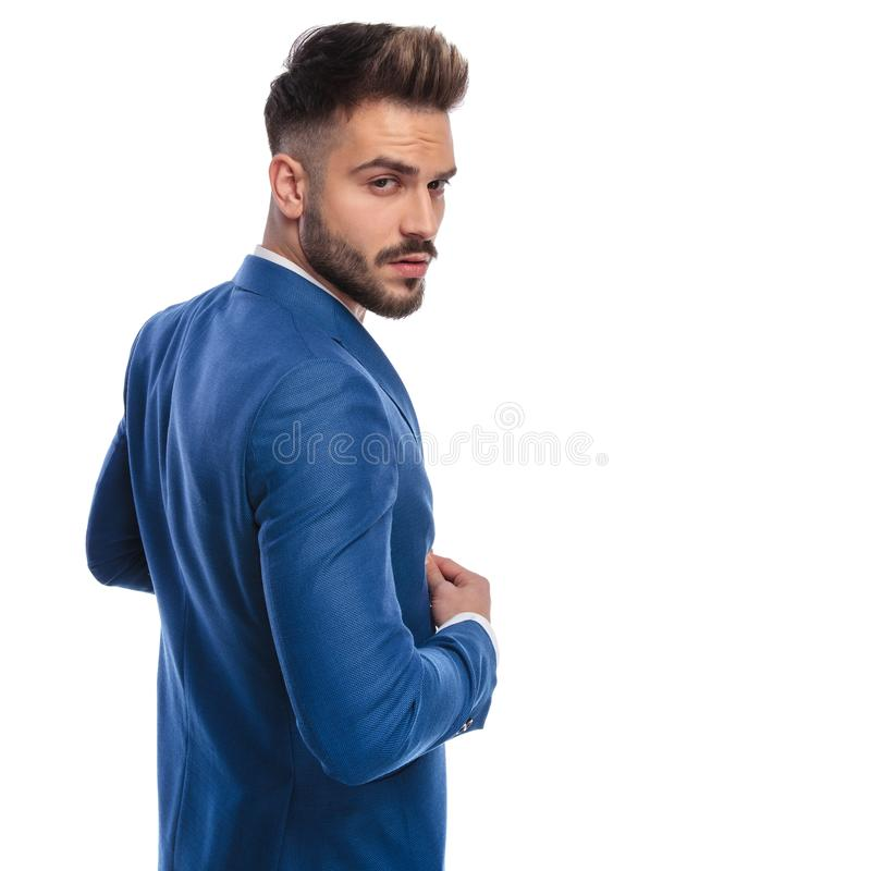Back side view of cool man buttoning his lounge jacket stock photos