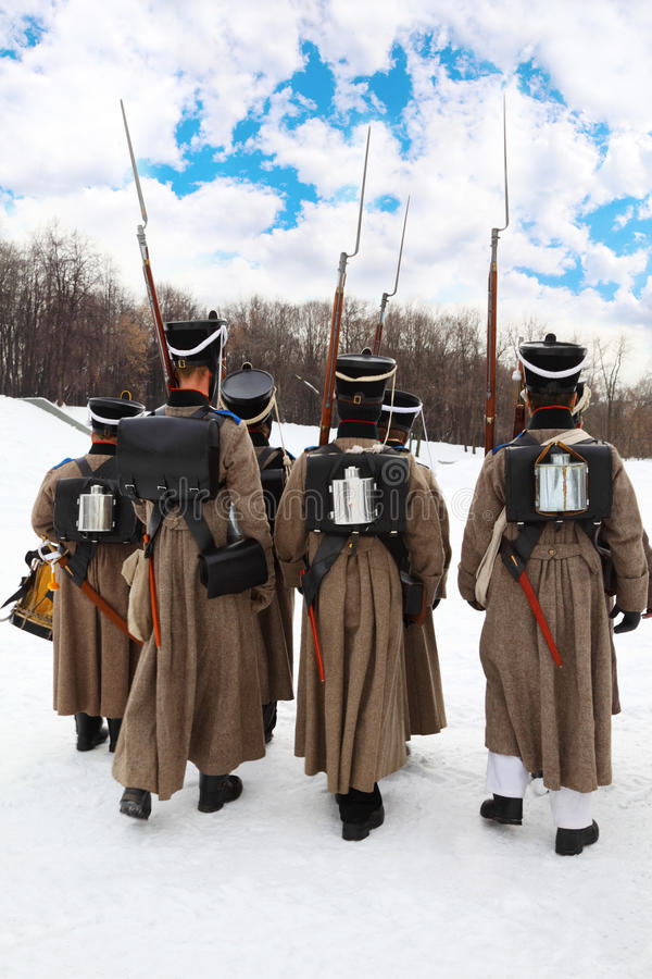 Back of soldiers at historical reconstruction royalty free stock image