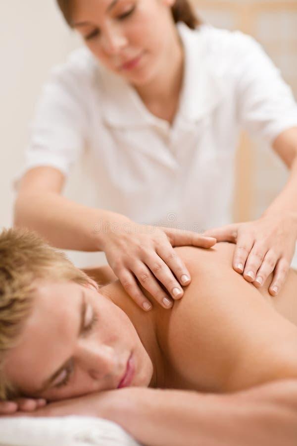 back som har lyxig manmassage fotografering för bildbyråer