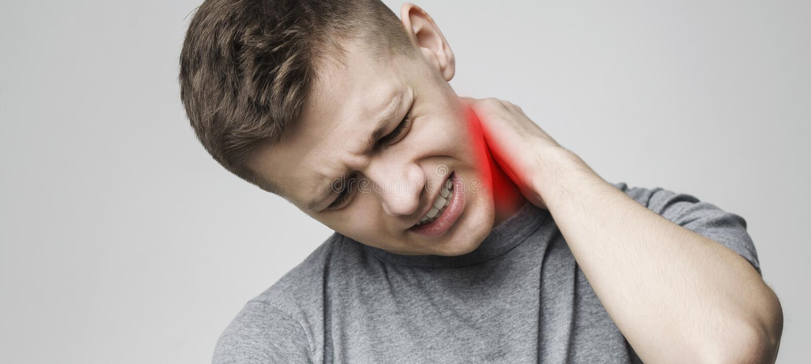 Tired man massaging his inflamed neck, panorama. Back and spine disease. Tired man massaging his neck, panorama royalty free stock photography