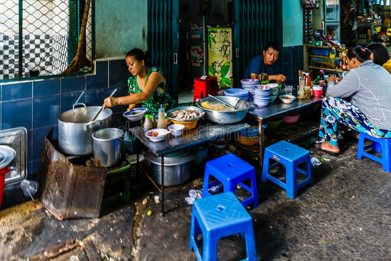 Back-street small restaurant at Xom Chieu Market, Saigon, South of Vietnam. Back-street small restaurant at Xom Chieu Market, District 4, Saigon, South of royalty free stock image