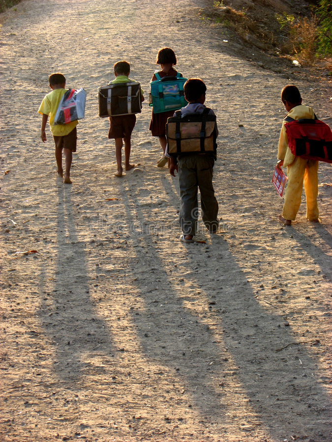 Back from Summer School. Poor children from rural going home barefeet after their day at the summer school stock photography