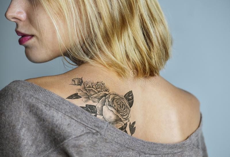 Back tattoo of a woman royalty free stock photography