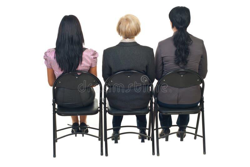 Back of three women at presentation royalty free stock photos
