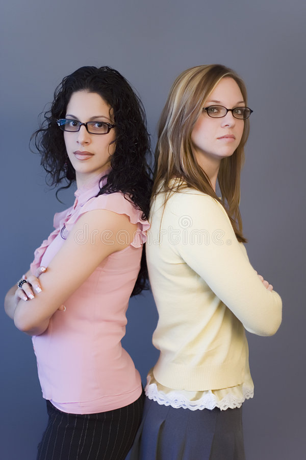 Back to back. Two women standing, facing oposite directions royalty free stock photo
