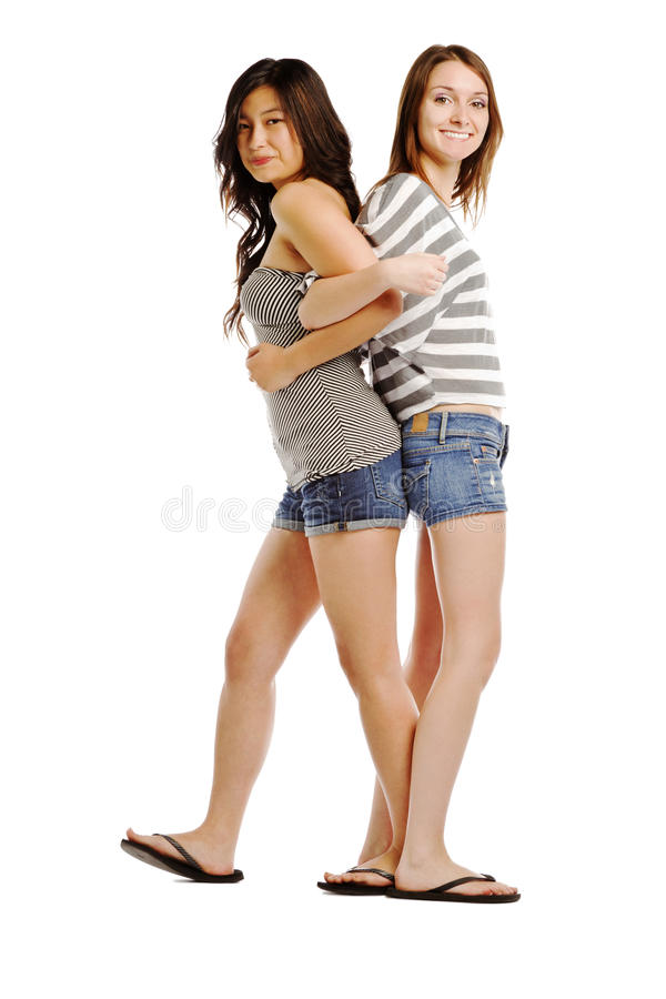 Back to back image of two young caucasians. Isolated on white royalty free stock photo