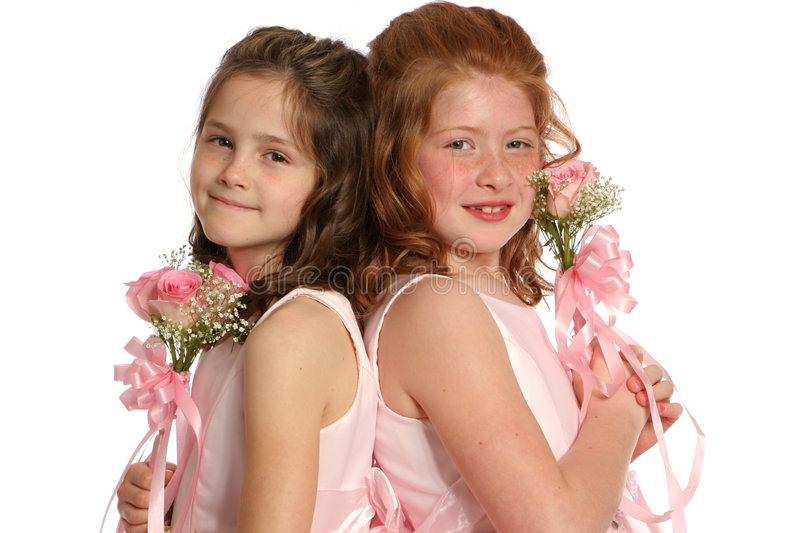 Back to Back sisters landscape. Isolated sisters in pink royalty free stock images