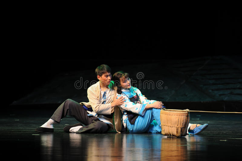 Back to back sitting on the ground- Jiangxi opera a steelyard. Jiangxi opera a steelyard is adapted from a true story: the last century fortys, the protagonists royalty free stock photo