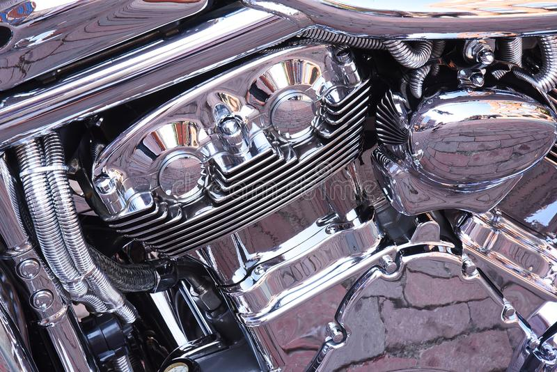 Back to the Bricks in Flint, Michigan. Chrome motorcycle reflects brick pavers at a huge bike show royalty free stock photos