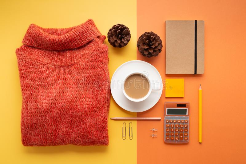 Back to office concept with supplies, coffee and sweater stock photography