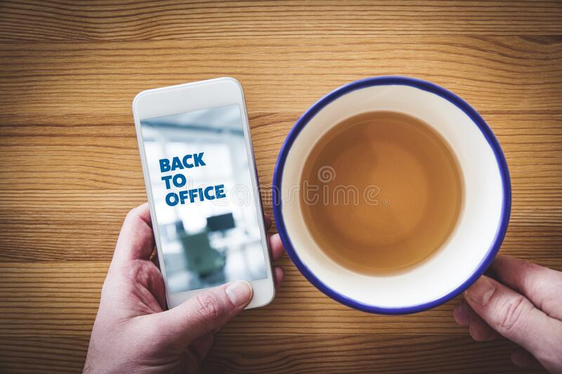 Back to office after covid-19 notification on smart phone stock image
