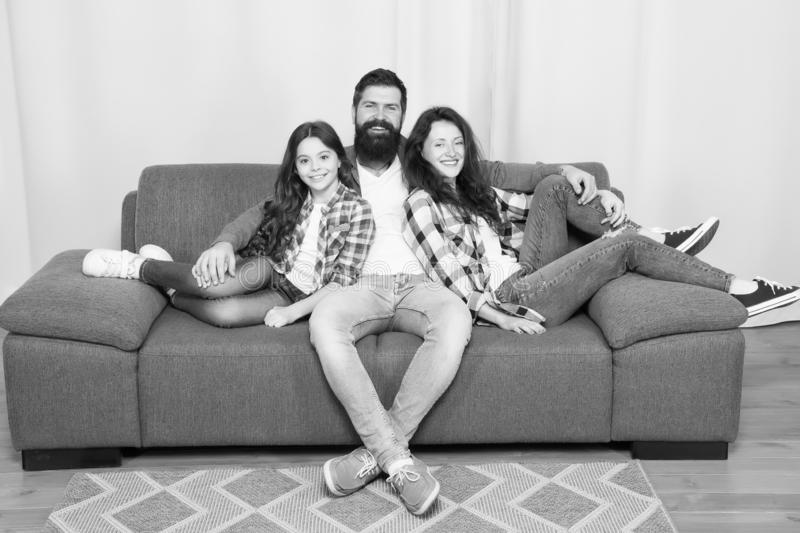 Back to our roots. Childrens day. Little girl love her parents at home. Happy family. Father, mother and little girl. Child at home. Family day. Bearded men and stock photography