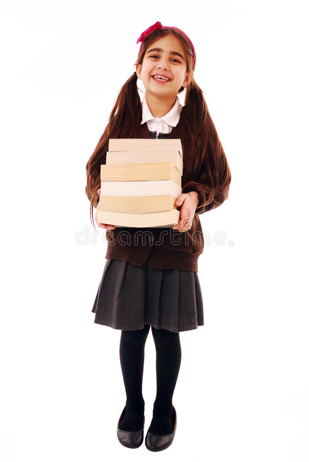 Back to school. Asian schoolkid smiling holding a stack on books isolated on white royalty free stock photography