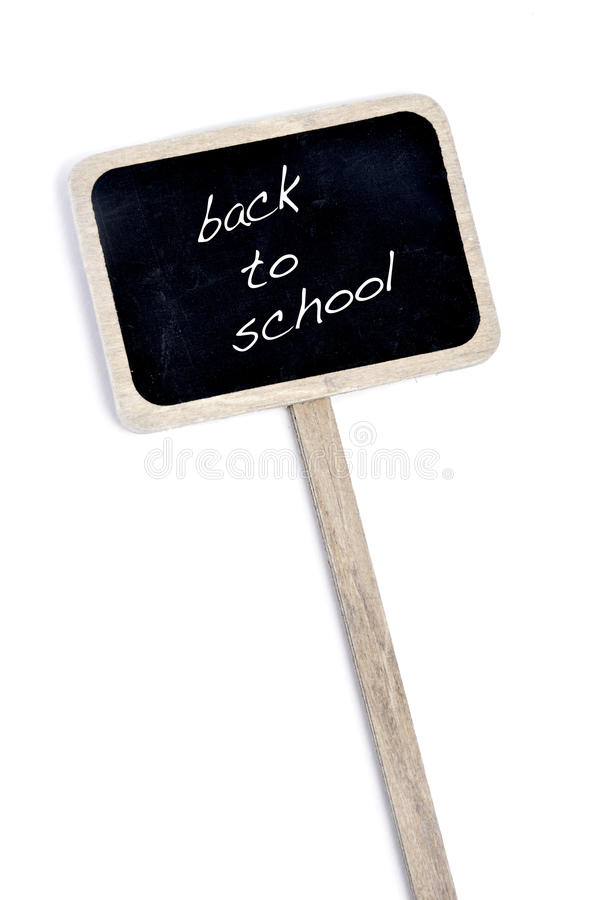 Back to school. Sentence back to school written in a blackboard label isolated on a white background stock photos