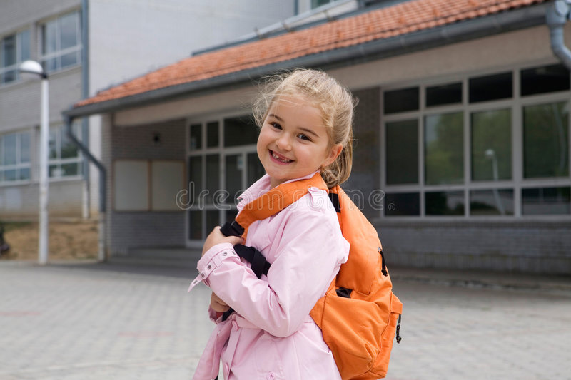Back to school. First grade student going to school, big smile, missing tooth stock photos